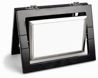 Black photo frame rotated in a plane isolated Royalty Free Stock Photos