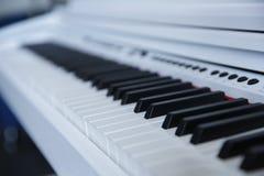 Black piano closeup on dark background royalty free stock photo