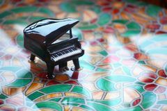 Black piano water table. Day light royalty free stock photo