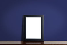 Black picture frame border on Navy classic background. Stock Images
