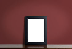 Black picture frame border on red classic background. Stock Images