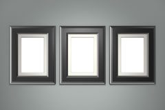 Black picture frame on gray wall Royalty Free Stock Image