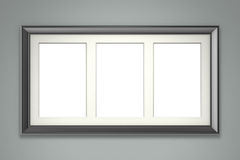 Black picture frame on gray wall Royalty Free Stock Photos