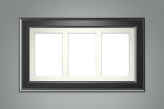 Black picture frame on gray wall Royalty Free Stock Photography