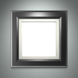 Black picture frame on gray wall stock illustration