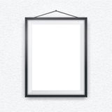 Black picture frame on a wall Stock Photography