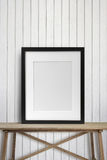 Black picture frame on wood table Royalty Free Stock Photography