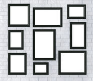 Black Picture Frames on a Brick Wall Royalty Free Stock Photos