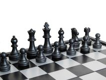 Black pieces on a chess board Stock Photo