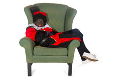 Black Piet lazy in chair Stock Photo
