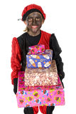 Black Piet with many presents Stock Image