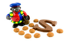 Black Piet with pepernoten and chocolate letter Royalty Free Stock Images