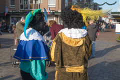 Black piet or zwarte piet celebrating arrival of Dutch Santa Clause, Sinterklaas royalty free stock photos