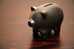 Black piggy bank Royalty Free Stock Photo