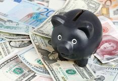 Black piggy bank on banknotes Royalty Free Stock Image