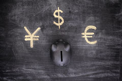Black piggy bank and Currency signs (Euro, Dollar, Yen) Stock Image