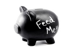 A piggy bank with the words Feed Stock Photography
