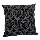 Black pillow. One black pillow with pattern isolated on white Stock Photo