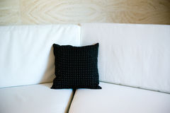 Black pillow on a sofa Stock Photography