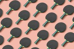 Black ping pong paddle on pink background stock photos