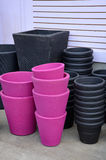 Black and pink flower pots Stock Photo