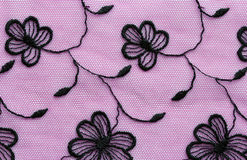 Black on pink flowers lace material texture macro shot Royalty Free Stock Image