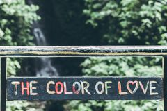 Black, Pink, Green, and Blue the Color of Love-printed Wall Decoration royalty free stock images