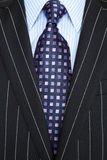 Black pinstripe suit and purple tie Royalty Free Stock Photography
