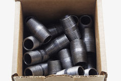 Black Pipe Fittings Boxed. A contractor's pack of close pipe nipples stock photo