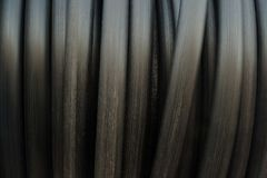 Black pipe hose roll background and texture. royalty free stock photography