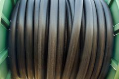 Black pipe hose roll background and texture. royalty free stock photos