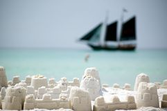 Black pirate tallship against sand castle Stock Photography