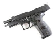 Black pistol. Closeup image of black pistol down on white background royalty free stock photo