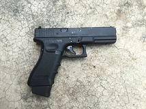 Black Pistol on the floor Royalty Free Stock Photo