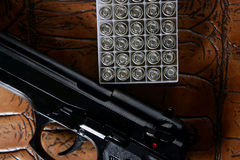 Black pistol handgun with bullet box Royalty Free Stock Photos