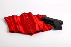 Black pistol with Red Sexy Corset on a white background Stock Photos