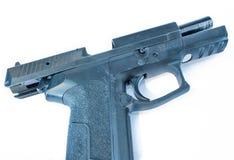 Black pistol on slide stop royalty free stock image