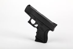 Black pistol on a white background Royalty Free Stock Image