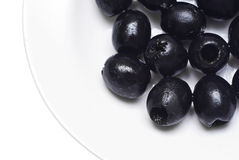 Black pitted olives  Stock Images