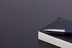 Black daily planner with luxury ball pen Royalty Free Stock Images