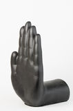 Black plaster hand against white background Stock Photo
