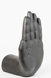 Black plaster hand against white background Stock Photos