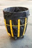 Black plastic bag bin. In garden Stock Photo