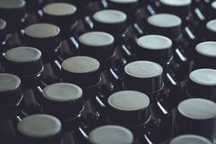 Black plastic bottle and cap Royalty Free Stock Photography