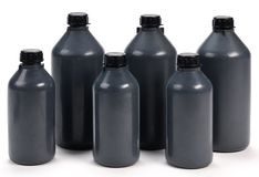 Black plastic bottle of various sizes Royalty Free Stock Image