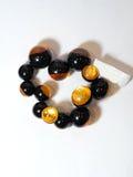 Black plastic bracelet ethnic. Black plastic bracelet on a white background ethnic Stock Photography