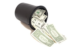 Black plastic bucket filled with dollar bills Stock Photo