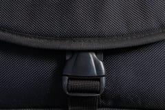 Black plastic buckle on bag. Locked black plastic buckle on bag Royalty Free Stock Photo