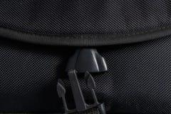 Black plastic buckle on bag. Unlocked black plastic buckle on bag Stock Photos