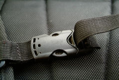 Black plastic buckle on strap Royalty Free Stock Images
